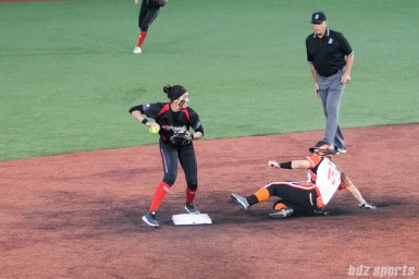Akron Racers second baseman Alex Hugo (16) looks to turn two after getting getting out Chicago Bandits infielder Emily Carosone (15).