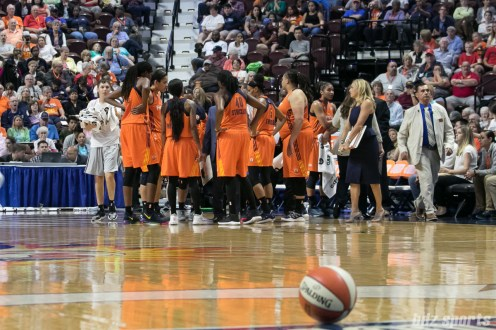 The Connecticut Sun huddle during a timeout.
