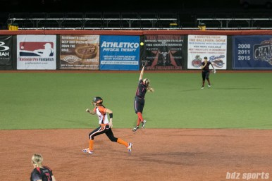 The ball flies over the reach of Akron Racers shortstop Ashley Thomas (1) during the Chicago Bandits' eight-run 5th inning.