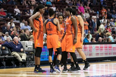 The Connecticut Sun huddle up before resuming play.