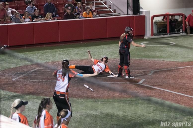 Chicago Bandits infielder Kristen Brown (44) slides home.