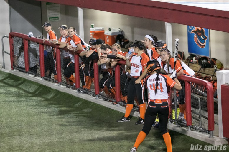 The Chicago Bandits dugout looks on.