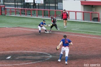Akron Racers second baseman Ashley Thomas (1) beats the throw to first.