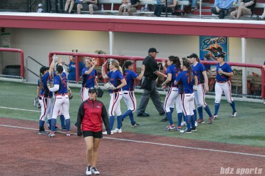 The Chicago Bandits high five at the end of their turn at defense.