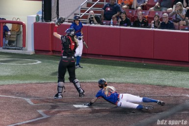 Chicago Bandits outfielder Brenna Moss (55) slides home safely, Chicago's second run of the inning.