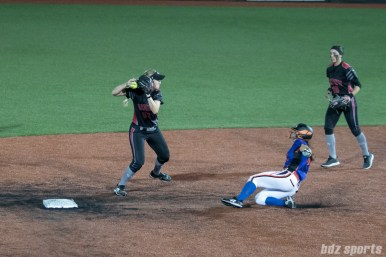 Akron Racers shortstop Sam Fischer (52) looks to make a double play.