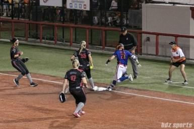 Akron Racers first baseman Jennifer Gilbert (25) just beats Chicago Bandits first baseman Megan Blank (21) to the first base bag.