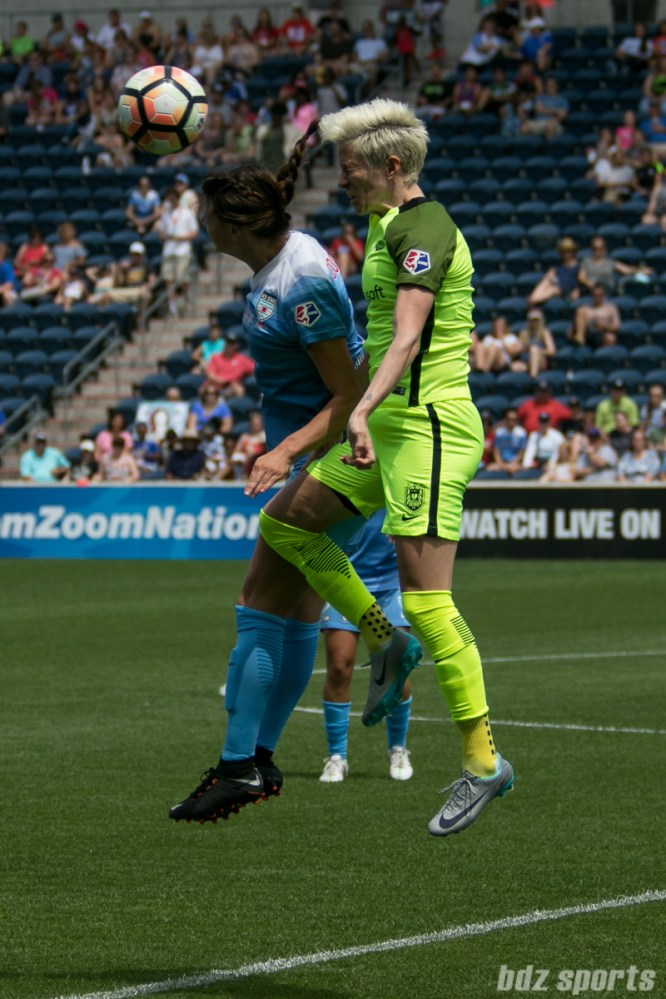 Seattle Reign FC forward Megan Rapinoe (15) challenges Chicago Red Stars defender Taylor Comeau (7) for the header.
