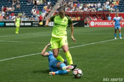Chicago Red Stars defender Julie Ertz (8) slide tackles the ball away from Seattle Reign FC midfielder Christine Nairn (2).