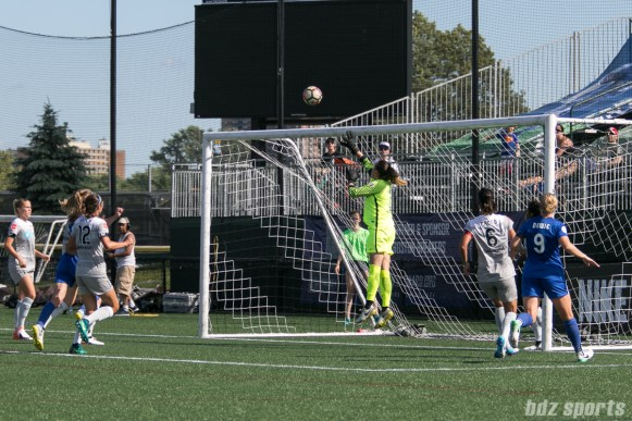 North Carolina Courage goalkeeper Katelyn Rowland (0) jumps to push the ball away from the goal.