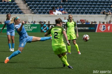 Chicago Red Stars defender Julie Ertz (8) attempts to block the pass by Seattle Reign FC midfielder Christine Nairn (2).