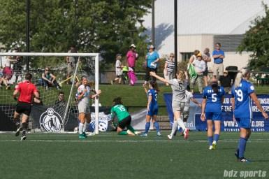 North Carolina Courage forward Ashley Hatch (12) looks to celebrate her goal with teammate midfielder Sam Mewis (5).