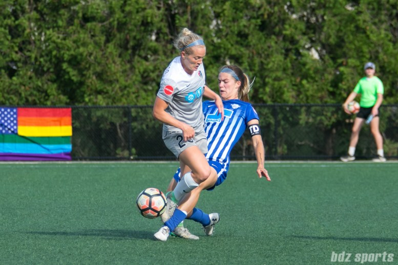 Boston Breakers defender Christen Westphal (20) tackles the ball away from North Carolina Courage forward Kristen Hamilton (23).