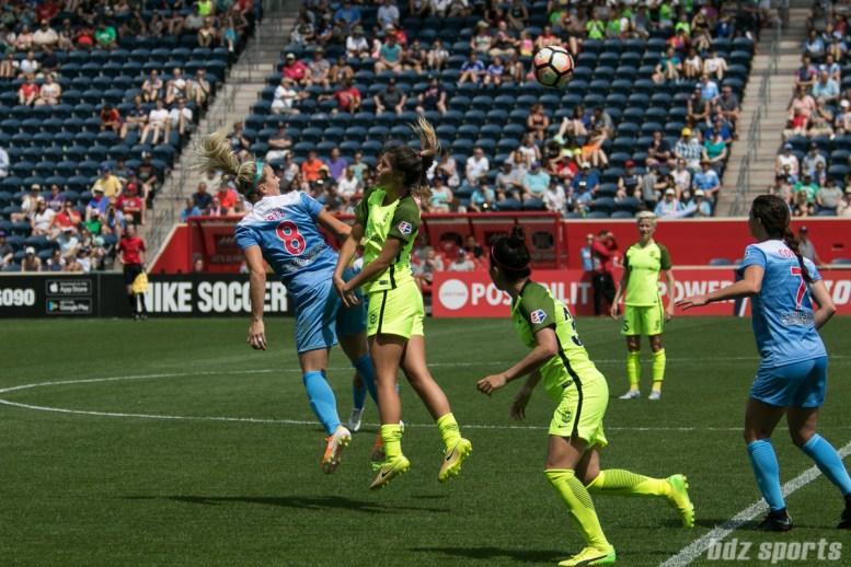 Chicago Red Stars defender Julie Ertz (8) heads the ball on.