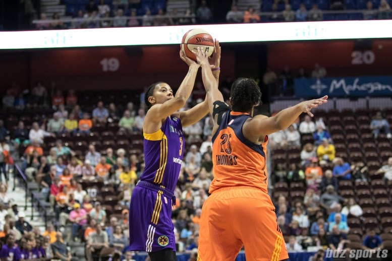 Los Angeles Sparks forward Candace Parker (3) looks to take a shot over the hand of Connecticut Sun forward Alyssa Thomas (25).