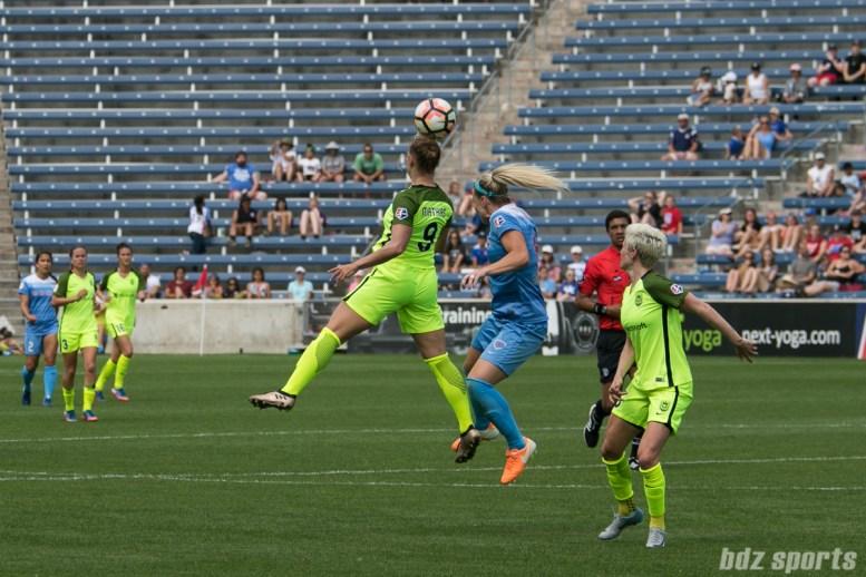 Seattle Reign FC defender Merritt Mathias (9) heads the ball.