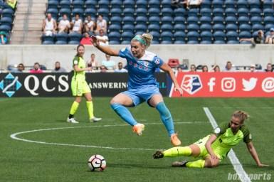 Chicago Red Stars defender Julie Ertz (8) breaks away from a sliding tackle by Seattle Reign FC defender Merritt Mathias (9) .