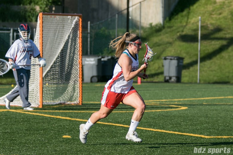Boston Storm defender Carly Cronin (7) carries the ball upfield.