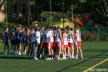 The Boston Storm huddle before the start of the second half.