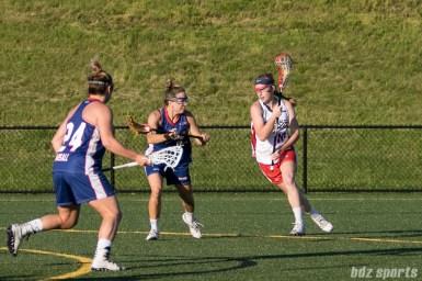 Boston Storm midfielder Lauren Kahn (10) takes the ball upfield against Long Island Sound midfielder Hillary Fratze (27).