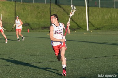 Boston Storm midfielder Abby Rehfuss (15) brings the ball upfield.