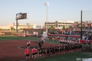 Players from the Chicago Bandits and Akron Racers stand for the playing of the national anthem prior to start of the game.
