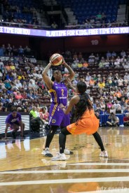 Los Angeles Sparks guard Riquna Williams (2) looks to make a pass while be defended by Connecticut Sun guard Courtney Williams (10).
