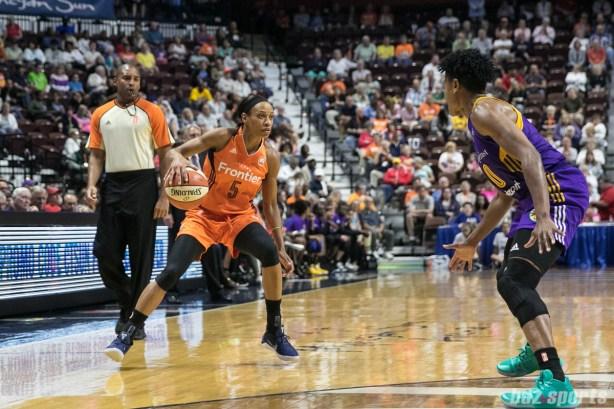Connecticut Sun guard Jasmine Thomas (5) looks to take on Los Angeles Sparks guard Alana Beard (0) 1-v-1.