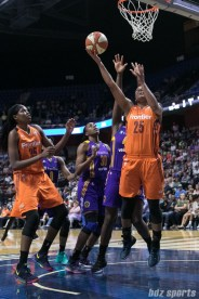 Connecticut Sun forward Alyssa Thomas (25) goes for the reverse layup against the Los Angeles Sparks.