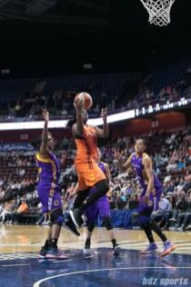 Connecticut Sun forward Shekinna Stricklen (40) drives to the basket through Los Angeles Sparks defenders.