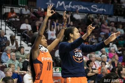 Connecticut Sun guard Courtney Williams (10) and forward Brionna Jones (42) celebrate a 3-pointer.