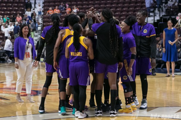 The Los Angeles Sparks huddle post-game after their win over the Connecticut Sun.