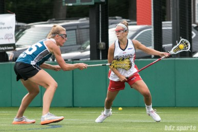 A Boston Storm player controls the ball behind the goal.