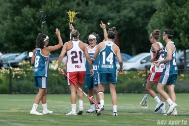 Philadelphia Force Carly O'Connell (10) celebrates her 2-point goal with teammates.