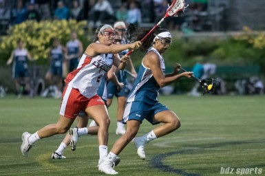 Philadelphia Force attacker Kara Mupo (8) breaks past Boston Storm defender Nicole Poli (21) towards goal.