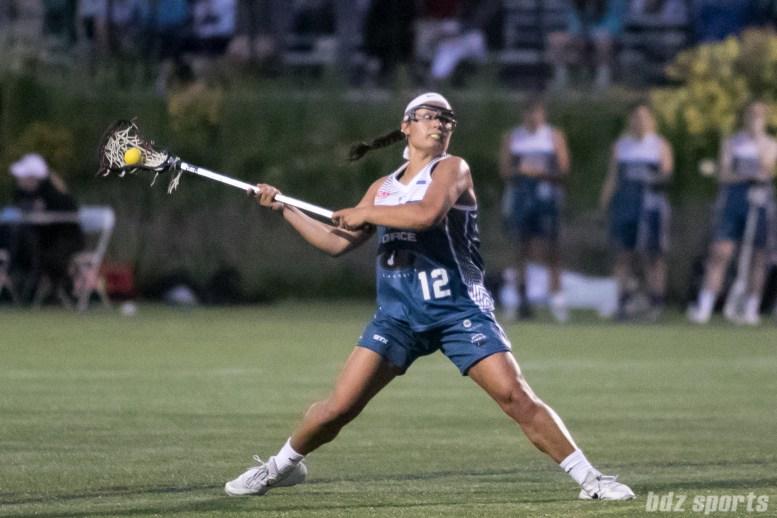 Philadelphia Force Julie Gardner (12) winds up for a shot on goal.