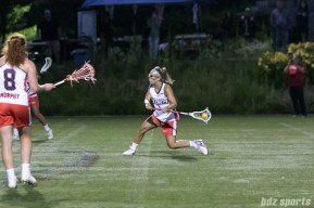 A Boston Storm player winds up for a shot on goal.