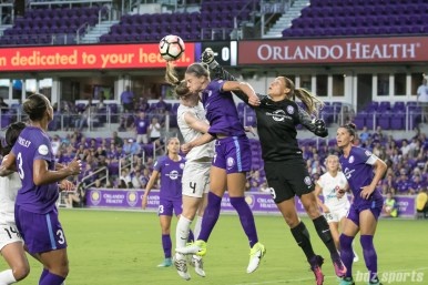 FC Kansas City defender Becky Sauerbrunn (4) and Orlando Pride players Alanna Kennedy (14) and Aubrey Bledsoe (19) battle for the ball off a corner kick.