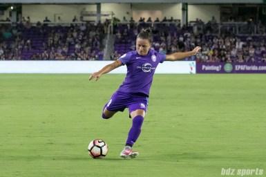 Orlando Pride defender Camila Pereira (9) takes a shot on goal.