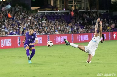 Orlando Pride defender Ali Krieger (11) gets a cross off ahead of FC Kansas City forward Sydney Leroux (14).