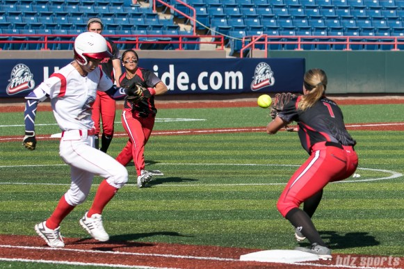 Akron Racers second baseman Ashley Thomas (1) gets the out at first.