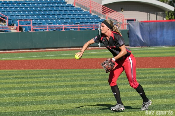 Akron Racers second baseman Ashley Thomas (1) makes an underhand throw to first base.