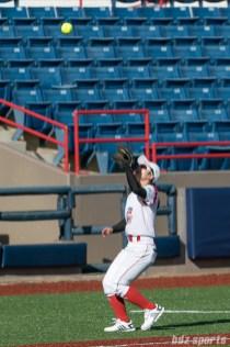 Beijing Eagles third baseman Wang Bei (15) catches a pop fly.