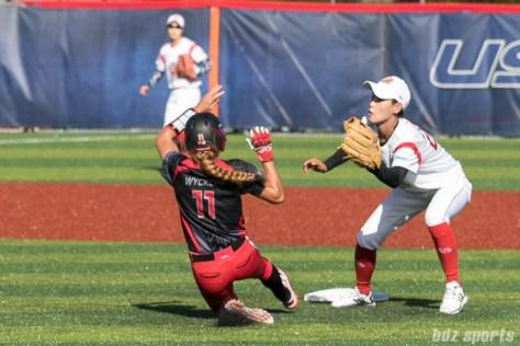 Akron Racers outfielder Kristen Wycoff (11) steals second base.