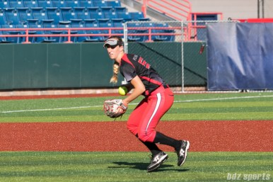 Akron Racers infielder Sam Fischer (52) looks to make the throw to first base.