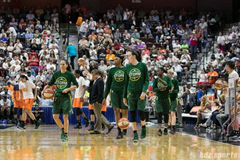 The Seattle Storm prepare to start the second half. At half time, the Connecticut Sun lead 48 - 38.