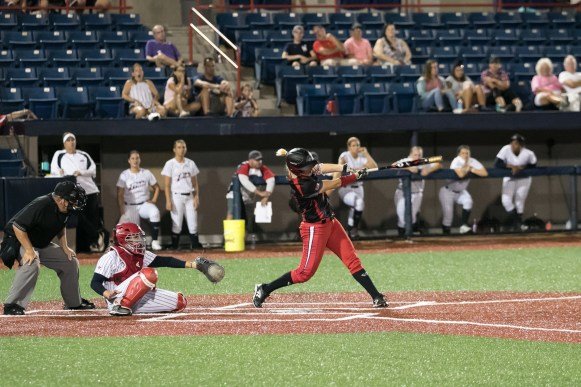 Akron Racers infielder Sam Fischer (52) hits a solo home run in the top of the fourth inning.