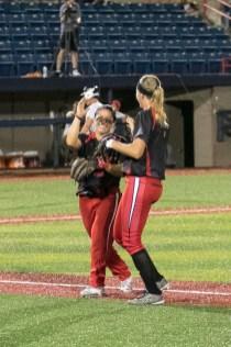 Akron Racers third baseman Kelley Montalvo (10) high fives teammate second baseman Ashley Thomas (1) .