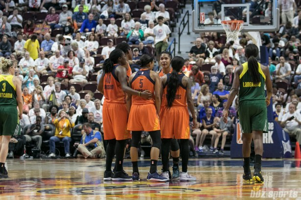 The Connecticut Sun huddle at the end of a timeout.