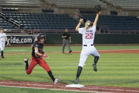USSSA Pride utility player Hallie Wilson (22) stretches to make the grab and get the out at first base.